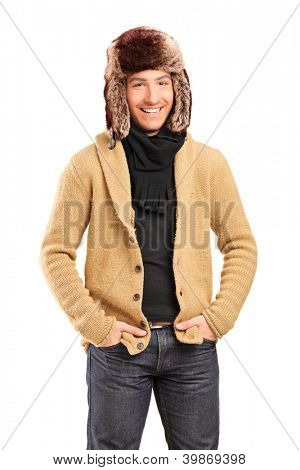 Handsome smiling man wearing fur hat isolated on white background