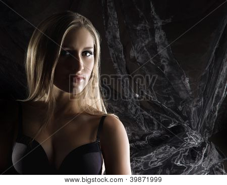 Portrait of young beautiful woman over retro background