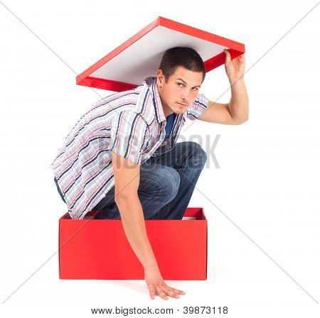 Young man in a box with lid over his head, seems depressed