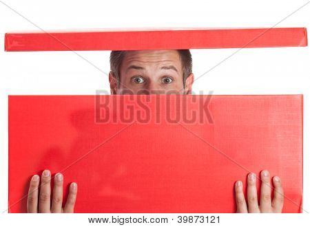 Surprised man with head in red box