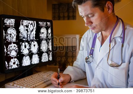 Doctor looking on ct scan at night duty