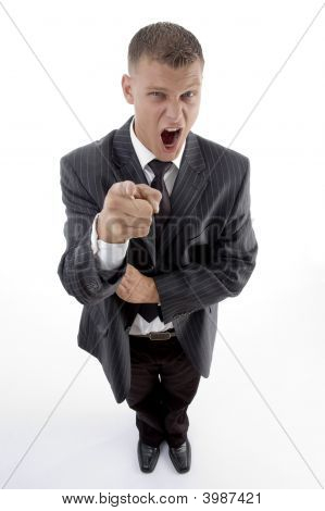 Standing Businessman Pointing At Camera