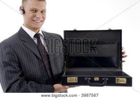 Smiling Businessman Showing His Empty Office