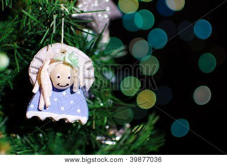 Close Up Christmas Tree With Handmade Decoration On Bokeh Lights Background