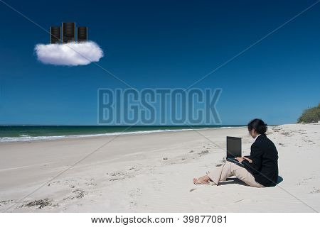 Businesswoman And Cloud Computing On Beach