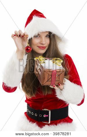 Santa Girl Holding Gift Box And Red Bauble.