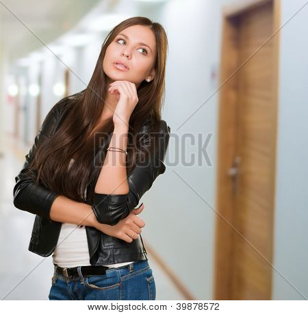 Portrait Of A Young Woman in a passage way