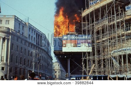 LONDON - MARCH 31: The South African embassy in flames during the Poll Tax Riots in Trafalgar Square on March 31, 1990 in London. The protests were against the introduction of the Community Charge.