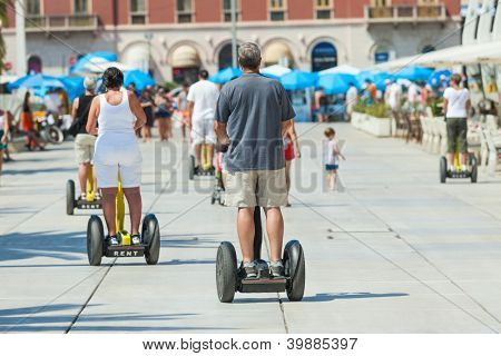 SPLIT, CROATIA - AUGUST 26, 2012: People on Segways on the waterfront in Split  on August 26, 2012 in Split, Croatia. Split is the second largest city in Croatia.