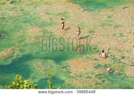 KRKA, CROATIA - JULY 28, 2012: People on the lake on July 28, 2012 in Krka, Croatia.The Krka National Park is one of eight national parks in Croatia.