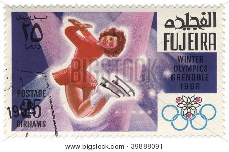 Figure Skating At The Winter In Grenoble On Postage Stamp