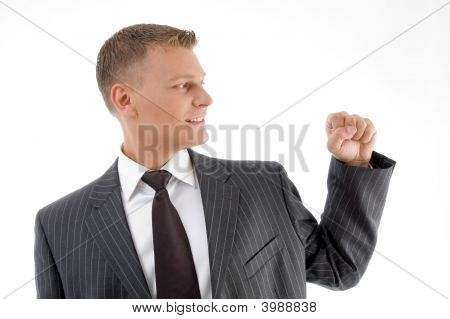 Smiling Businessman Looking His Fist