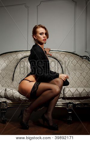 Young Woman  Sits On The Couch