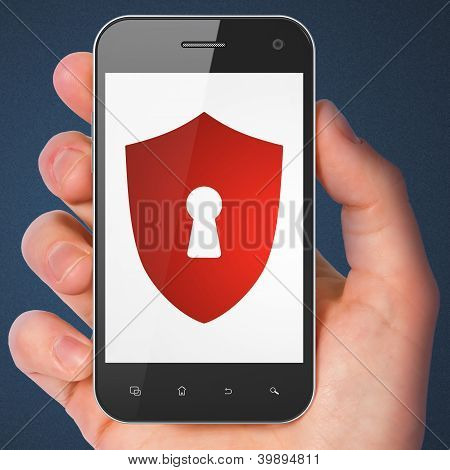 Hand holding smartphone with shield with keyhole