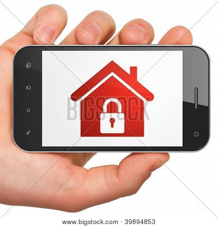 Hand holding smartphone with home on display. Generic mobile sma