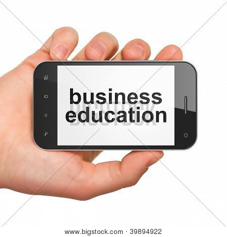 Hand holding smartphone with word business education on display.