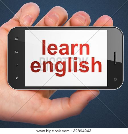 Hand holding smartphone with word learn english on display. Gene