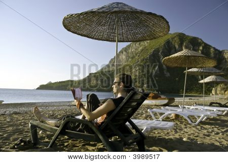 Man Sunbathing On Tropic Beach