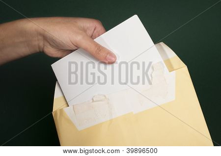 Hand That Open A Letter From Brown Envelope