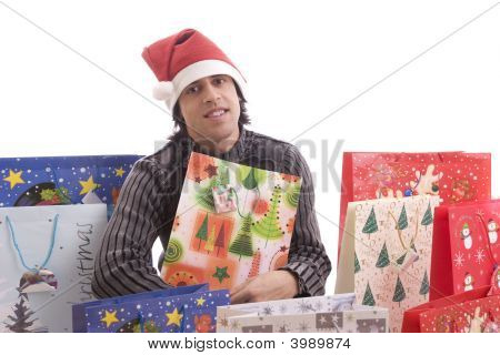 Young Man In Santa Hat, Full Of Gifts