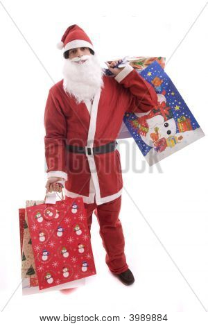 Young Man In Santa Costume, Full Of Gifts