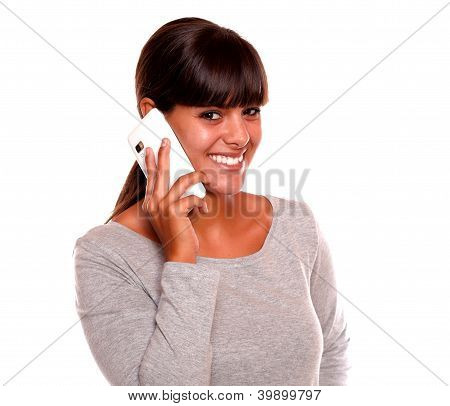 Attractive Young Female Speaking On Cellphone