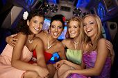foto of limousine  - Beautiful young girls having party in limousine - JPG