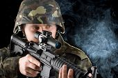 picture of m16  - Soldier with the smoking gun in studio - JPG