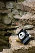 Small Slr Film Camera On Rocks