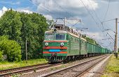 Freight Train Hauled By Electric Locomotive. Ukrainian Railways