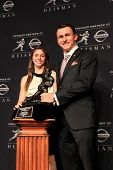NEW YORK-DEC 8: Texas A&M quarterback Johnny Manziel, winner of the 2012 Heisman trophy, stands with