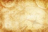 image of buccaneer  - parchment style background with compass and antique pistol - JPG