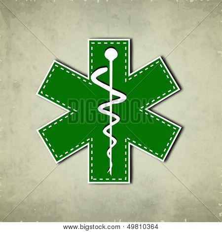 Caduceus medical symbol on vintage background.