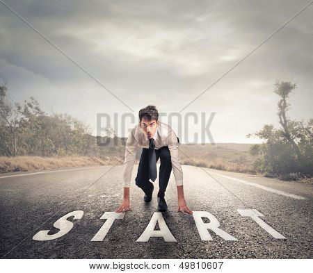 young businessman in the starting position