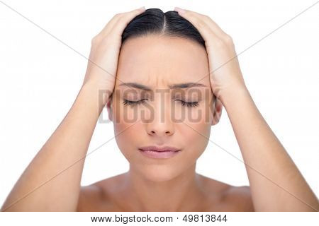 Young woman having strong headache on white background