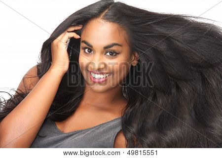 Beautiful Woman Smiling With Flowing Hair Isolated On White