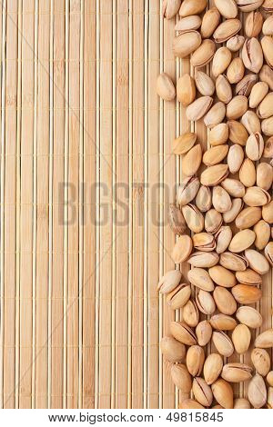 Pistachios  Lying On A Bamboo Mat