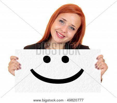 Smile. Smiling young woman holding up white banner