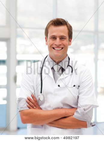 Male Doctor With Folded Arms Looking At Camera