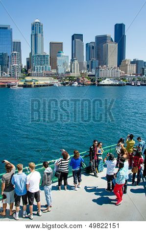 Tourists on ferry approaching Seattle