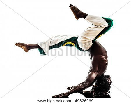 one brazilian  black man dancer dancing capoiera on white background
