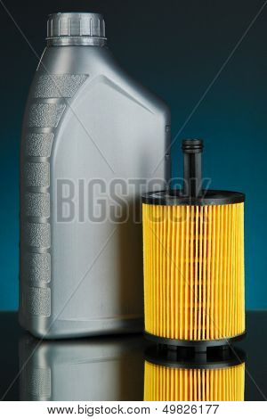 Car oil filter and motor oil can on dark color background