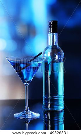 Glass of cocktail on bright background