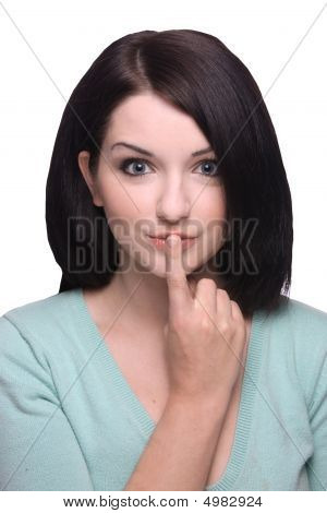 Attractive Brunette Girl With Finger On Lips On White