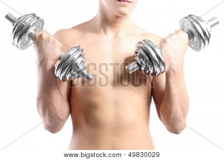 Handsome young muscular sportsman execute exercise with dumbbells, isolated on white