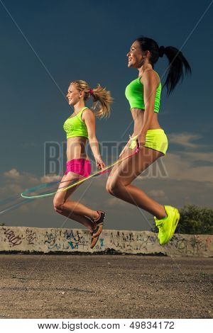 Summer vacation - women with skipping rope