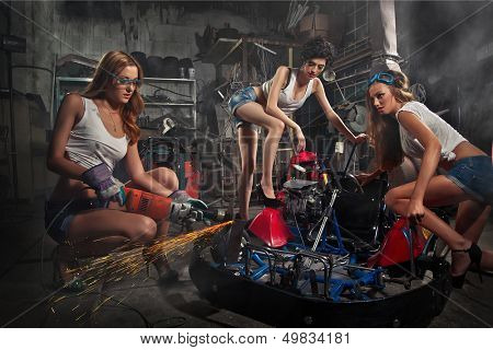 Girls at a garage next to the Go-kart  in smoke