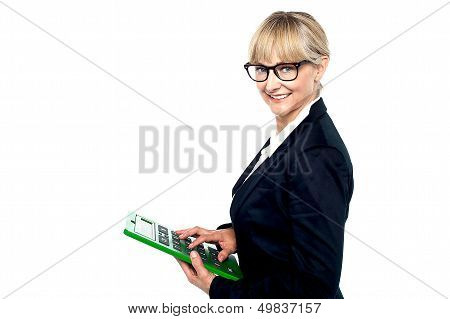 Bespectacled Entrepreneur Using A Calculator