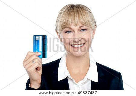 Joyous Female Employee Showing Credit Card