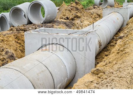 Concrete drainage pipe and manhole under construction